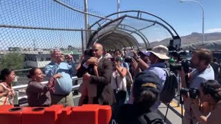 Cory Booker escorts asylum seekers into the U.S.