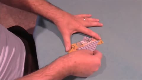 A Playing Card Slices Through A Bill With No Damage Noted