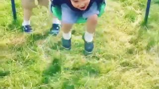 Collab copyright protection - boy pushes boy swing grass faceplant - Video
