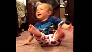 Laughing baby falls over from excitement - Video