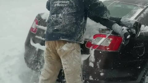 Dad Hilariously Uses Son To Clean Snow Off Car