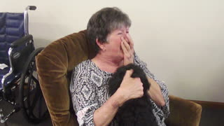 Woman's emotional reunion with missing dog - Video