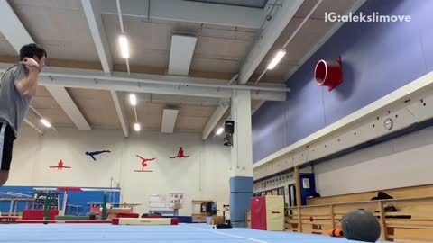 Guy does flips on gymnastics tumbling mat, falls, and lands on shoulder
