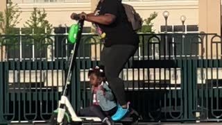 Lady on Scooter Loses Her Child