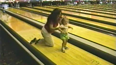 Mom And Daughter Slip And Fall Chasing A Bowling Ball