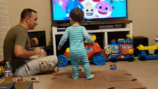 Dad constructs dance floor for baby to dance to 'baby shark'