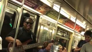 Guy singing lil jon yeah on subway guitar - Video