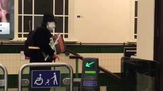 Person carrying stuff with mask and hat in subway station