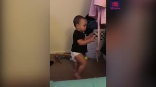 Adorable baby boxer tries out moves