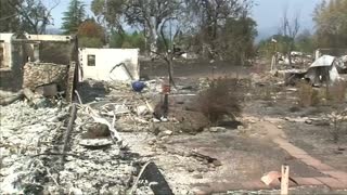 Residents survey wildfire damages in California - Video