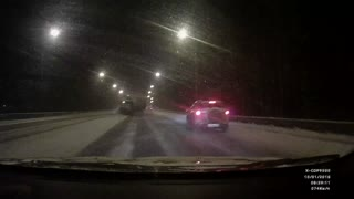 Truck Slides Out On Icy Highway