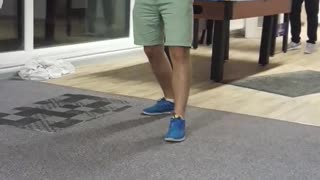 Guy in purple shirt gets dart tossed on his foot - Video