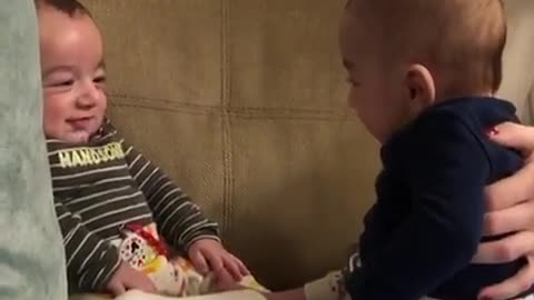 4-month-old twins make each other laugh