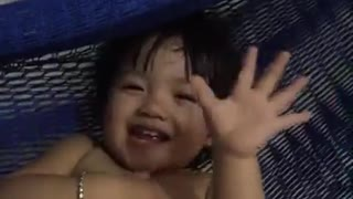 Baby girl play teeter with mother very funny  - Video