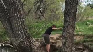 Brown shirt kid fails to clear creek on rope swing - Video
