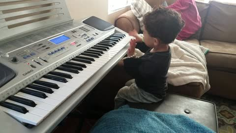 2-year-old boy rocks out to Hero from a MIDI keyboard