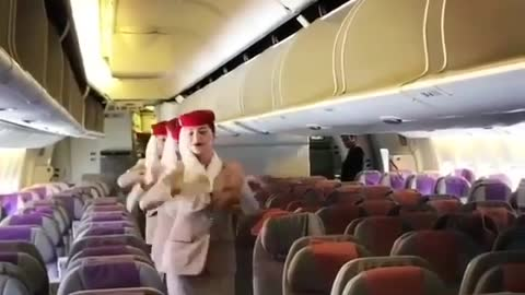Red hat cabin crew dancing three ladies