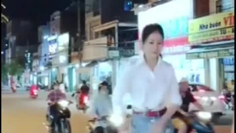 girl jumping in the middle of the road causing chocolate