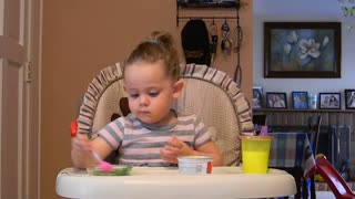 Toddler Adorably 'Curses' At Slippery Food - Video