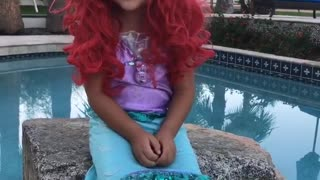 Little girl playing dress up and singing  - Video