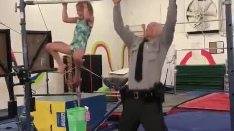 7-year-old gymnast challenges state trooper to pull-up challenge