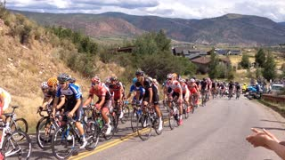 Motorbike crashes into cyclist at the USA Pro Challenge - Video