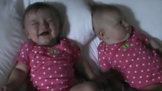 Funny Baby Makes Her Twin Sister Laugh - Video