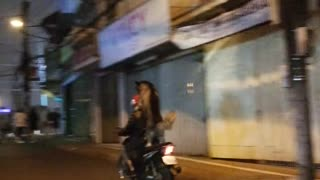 Husky goes for ride on back of scooter in Vietnam