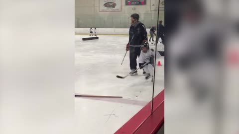 Hockey Kid Bowls Over Other Kids After Falling