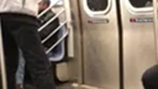 Man plays ping pong two paddles on subway