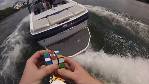 Solving a Rubik's Cube while wake surfing