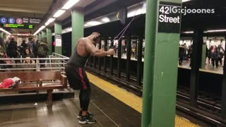 Pt. 1 guy works out in subway station using suspension ropes