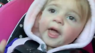 Little girl adorably determined to pick her nose - Video