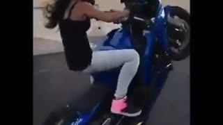 Girl doing stunts on a motorcycle - Video