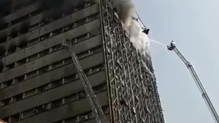 Seventeen story building collapses in Iranian capital Tehran - Video