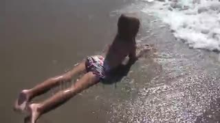 child playing in sea sand beach little girl on tropical exotic sea coastline - Video