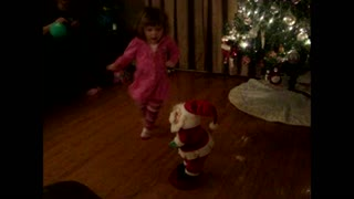 Young girl and santa shake their groove thing on the dance floor - Video
