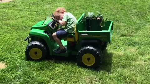 Kid literally falls asleep while driving tractor
