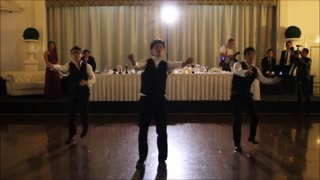 Groomsmen perform epic surprise wedding dance