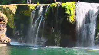 Epic cliff dive from stunning Washington waterfall
