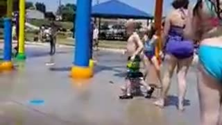 Negligent Babysitter Puts Baby Under Water Buckets at Splash Pad - Video