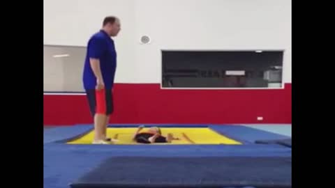 Man catches his son on trampoline