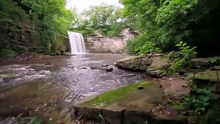 Distant waterfall with running river