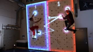 Futuristic augmented rock wall combines climbing with pong - Video
