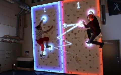 Futuristic augmented rock wall combines climbing with pong