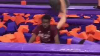 Guy backflip foam pit girl falls on top - Video