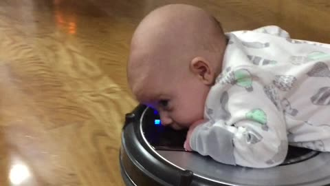 """Baby Adorably Rides On """"Roomba"""""""