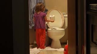 Little Tot Caught Red-Handed Dumping Paper Into Toilet  - Video