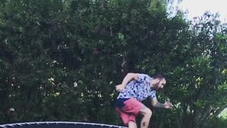 Trampoline pink shorts falls bushes - Video