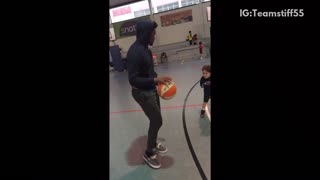 Man plays indoor basketball with toddler - Video